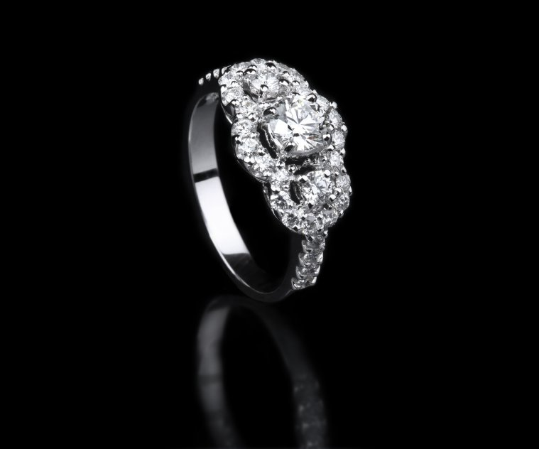 White gold diamond ring standing position on black background royalty-free stock photo